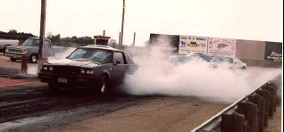 Ken's car doing a burnout